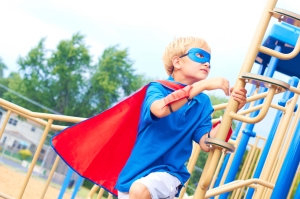 Superhero Kid Playing On Play Set