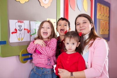 iStock_happy kids with teacher(Top10)