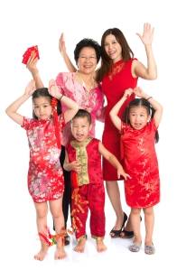 Asian Chinese family wishing you a happy Chinese New Year