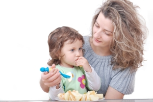 Good Manners Matter-helping daughter eat