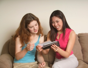Two friends looking at photos