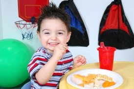 Adorable Preschooler Eating Snacks