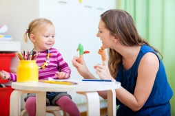 Mother and daughter playing with finger toys