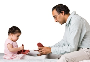 Man Helping Daughter with Shoes