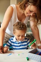 Preschool Teacher Looking at the Kid's Drawing