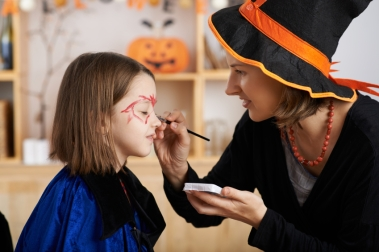 Applying Halloween make-up