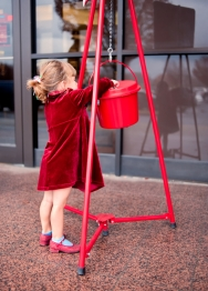 Child Making a Donation