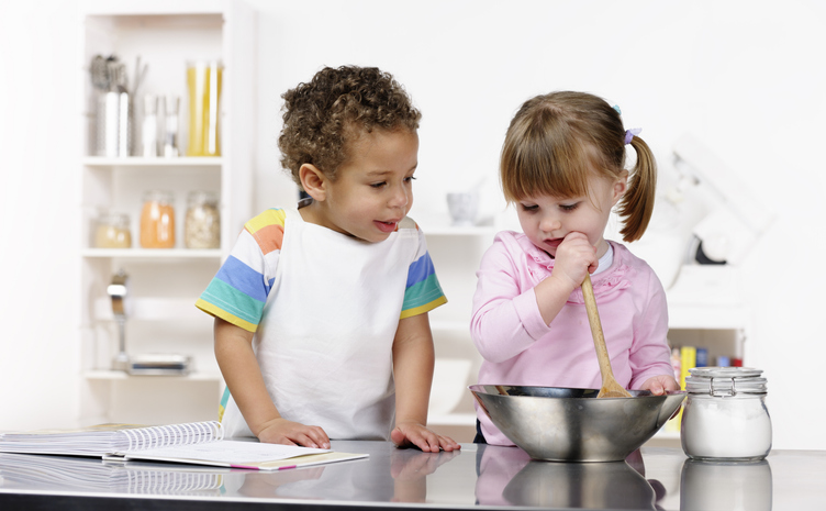 Little Boy And Girl Preparing Food In The Kitchen