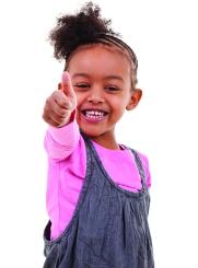 Cute little girl making thumbs up